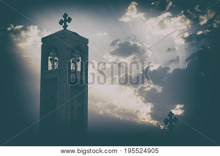 The Chatolic Church In The Light Of Cloudy Sunset
