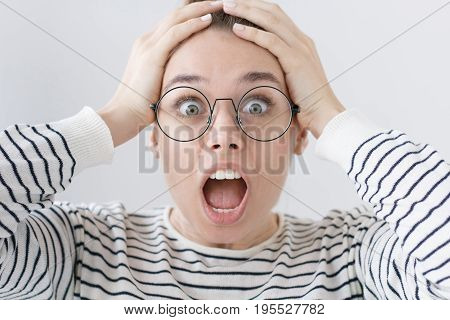 Closeup Of Emotional Teenage Girl Isolated On Gray Background With Strong Expression Of Fear, Round