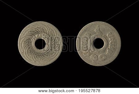 Old coin Thailand which is obsolete today isolated on black background 10 Satang with clipping path