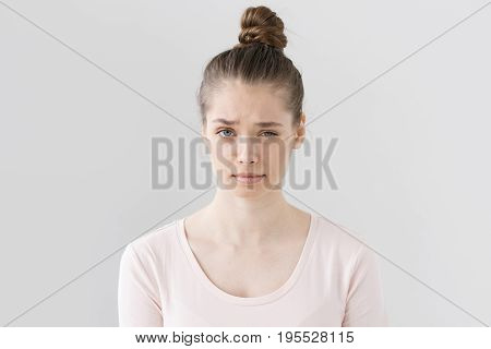 Closeup Picture Of Nice Young Female Without Make Up Isolated On Grey Background Raising Eyebrow Wit
