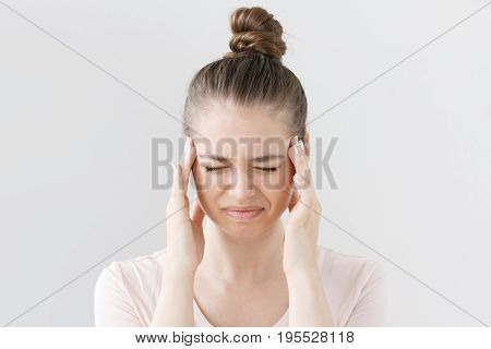 Portrait Of Good-looking Teenage Girl Isolated On Grey Background Suffering From Severe Headache, Pr
