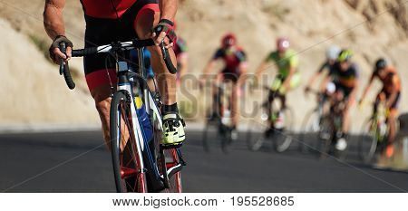Cycling competition,cyclist athletes riding a race,climbing up a hill on a bicycle