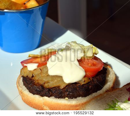 Hamburger meal served with french fries. Fast food.