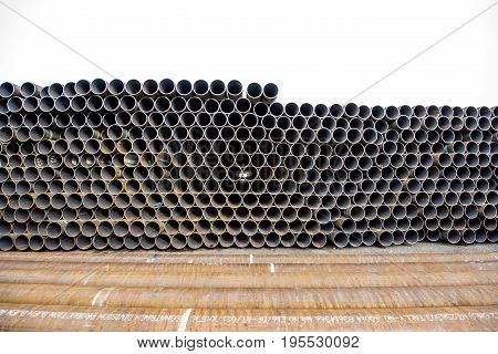View on the pile of rusty steel pipes outdoors