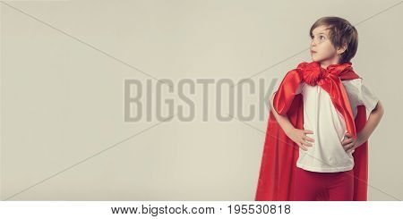 Female Superhero Kid Posing In Studio