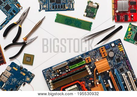Electronics repair and upgrade background, copy space. Motherboard top view, flat lay. Technology maintenance, electronics repair shop concept