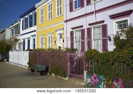 VALPARAISO, CHILE - June 1, 2017: Colourfully painted houses on Paseo Atkinson overlooking the harbour of the UNESCO World Heritage City of Valparaiso in Chile.