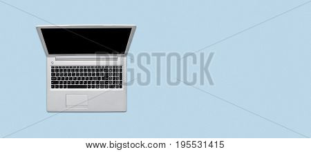 Top View Of Modern Opened Laptop With Blank Sreen Lying On Blue Background. Horizontal Shot Of Lapto