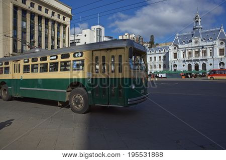 VALPARAISO, CHILE - July 14, 2017: Historic trolleybus passing through Sotomayor  Plaza in the UNESCO World Heritage City of Valparaiso in Chile