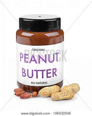 Creamy peanut butter in jar on white background