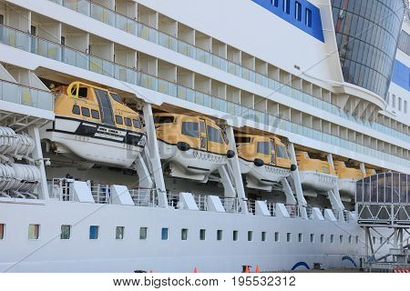 IJmuiden the Netherlands - April 30th 2017: Aida Sol docked at the Felison Cruise Terminal detail of safety vessels