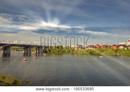river on the background of blue sky beautiful clouds in the summer the beautiful cityscape pleasure boats on the river under the summer blue sky