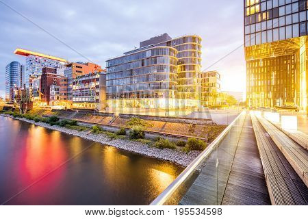 Night view on the modern financial district with illuminated buildings in Dusseldorf city, Germany