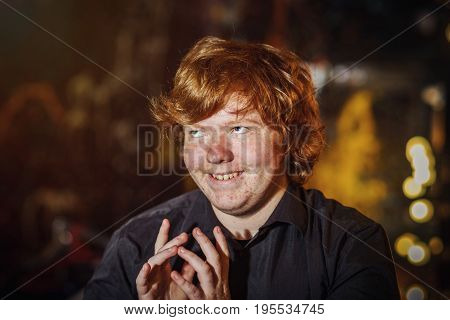 Red-haired Teenage Boy With Crafty Plans