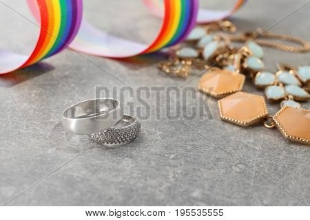 Silver rings for lesbian wedding on gray table