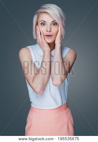 beautiful young surprised woman, isolated