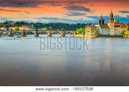 Amazing colorful sunset and spectacular cityscape with old stone Charles bridge in Prague Czech Republik Europe