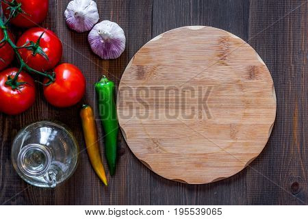 Mockup for menu. Cutting board and vegetables on wooden table background top view.