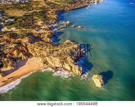 Algarve, Portugal: aerial UAV photo of the coast at sunset