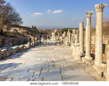 Roman Stone Pillars And Statue Ruins On Road Side In Ephesus Archaeological Site In Turkey