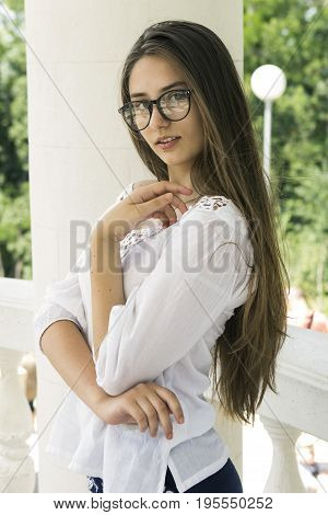 Portrait of a young innocent girl in white outdoor shot