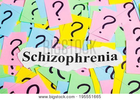 Schizophrenia Syndrome text on colorful sticky notes Against the background of question marks