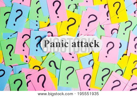 Panic Attack Syndrome text on colorful sticky notes Against the background of question marks