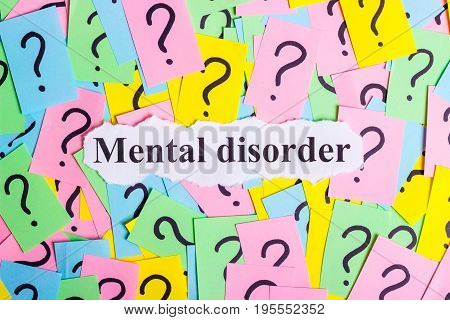 Mental Disorder Syndrome text on colorful sticky notes Against the background of question marks