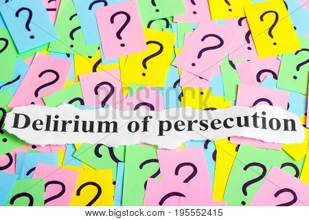 Delirium of persecution text on colorful sticky notes Against the background of question marks