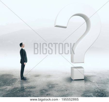 Side view of young adult businessman looking at question marks on abstract foggy gray background. Interrogation concept. 3D Rendering