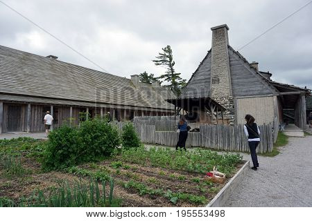 MACKINAW CITY, MICHIGAN / UNITED STATES - JUNE 18, 2017: Vegetables grow in raised vegetable garden beds in Fort Michilimackinac, at the Colonial Michilimackinac State Park.
