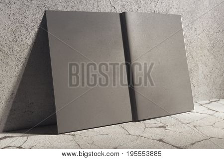 Side view of open gray hardcover notepad leaning on concrete wall. Abstract supplies stationery items. Mock up 3D Rendering