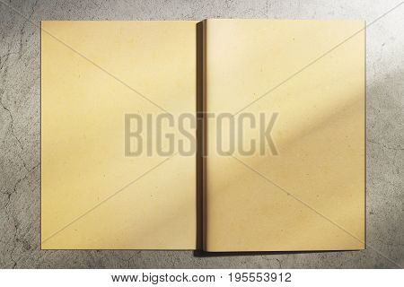 Back view of open aged hardcover notepad on concrete background. Mock up 3D Rendering