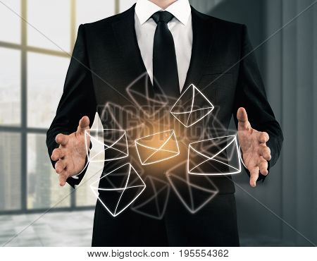 Businessman holding glowing digital letters in blurry interior. Technology and communication concept. 3D Rendering
