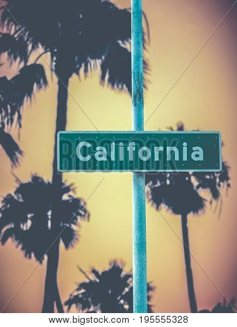 California Street Sign Against Retro Style Golden Palm Trees