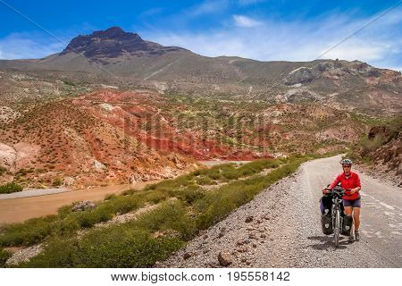 Woman cycling on the famous national Ruta 40 Quarenta in the remote part of central Argentina