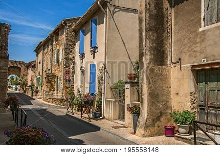 Châteauneuf-du-Pape, France, July 02, 2016. Street view with stone houses in the city center of Châteauneuf-du-Pape hamlet. Near Avignon, Vaucluse department, Provence region, southeastern France