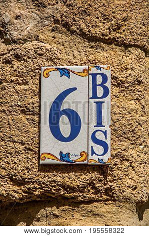 Châteauneuf-du-Pape, France, July 02, 2016. Close-up of street numbering made in ceramic in Châteauneuf-du-Pape. Near Avignon, Vaucluse department, Provence region, southeastern France