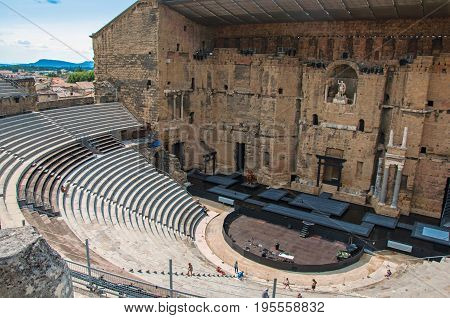 Orange, France, July 02, 2016. View of the Roman Theater of Orange with blue sky and sunny day. Located in the Vaucluse department, Provence-Alpes-Côte d'Azur region, southeastern France