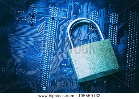 Padlock on computer motherboard. Internet data privacy information security concept.