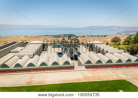 GALILEE ISRAEL - JUNE 24: The statues of Jesus and Twelve Apostles in Domus Galilaeae on the Mount of Beatitudes near the Sea of Galilee Israel on June 24 2017