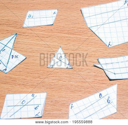 Geometric figures drawn by hand on a wooden background science and education