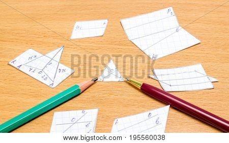 Geometric shapes pen and pencil on wooden background tools for education