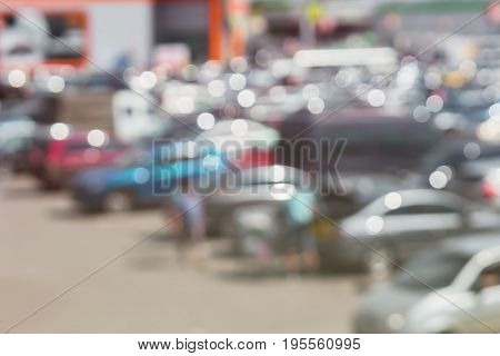 Abstract blurred parking next to modern shopping mall at peak hour. For background , backdrop. With place for your text