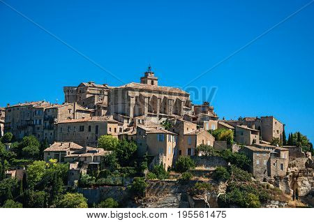 Close-up of the village of Gordes on top of a hill and under sunny blue sky. Located in the Vaucluse department, Provence region, in southeastern France