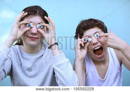 Boy And Girl With Jujube Marshmellow Eyes Smiling Open Mouth Close Up Portrait