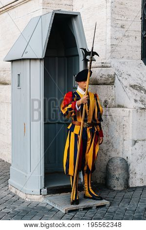 Rome Italy - August 19 2016: Papal Swiss guard standing at his post. The Swiss guards served since the late 15th century.