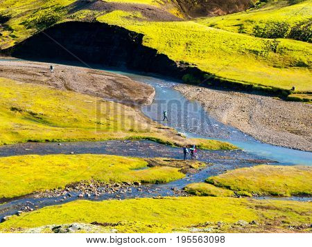 Green hilly landscape of Iceland Highlands with glacier river around Laugavegur hiking trail on sunny day, Iceland.