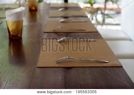Spoon And Fork On Tablecloth