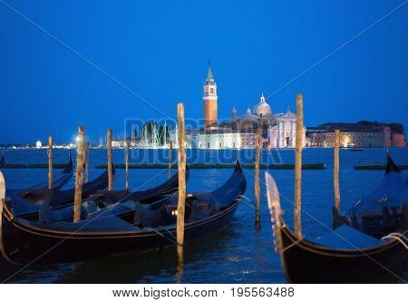 gondolal at night and San Giorgio Maggiore church, Piazza San Marco, Venice, Italy